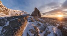 Stone House Located On Rocky Mountain In Winter Time At Sunset