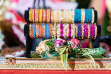 Closeup Of Colorful Bangles And Vibrant Flowers On A Bokeh Background At An Indian Party