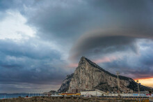 View From La Linea De La Concepcion To The Rock Of Gibraltar And A Dramatic Storm Sky Above It