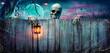 Leinwandbild Motiv Halloween - Skeleton Holding Lantern On Wooden Banner In Night