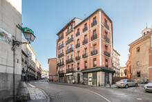 Vintage Buildings On The Rise Of Segovia Street Through The Historic Center Of Madrid