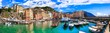 Leinwanddruck Bild - Camogli - beautiful colorful town in Liguria, panorama with traditional fishing boats .popular tourist destination in Italy