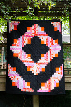 Bold Patterned Quilt Hanging Outside