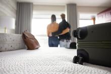 Couple Hugging In Hotel Room
