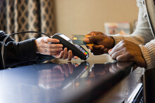 Man Paying Bill In Hotel