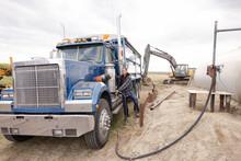 Male Farmer Filling Semi Truck Gas Tank On Farm