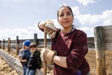 Portrait Hard Working Female Farmer With Kids On Sunny Rural Farm