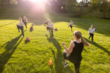 Fitness Teacher And Students Running On Spot In Park