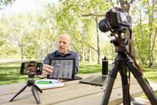 Man Videoing Online Class, Using Digital Tablet In Park