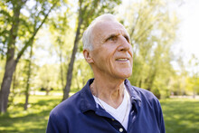 Close Up Of Cheerful Senior Man In Park