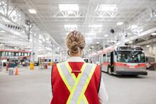 Female Supervisor In Reflective Vest In Maintenance Facility