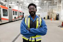 Portrait Confident Male Worker In Maintenance Facility