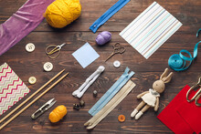 Composition With Knitting Supplies On Dark Wooden Background
