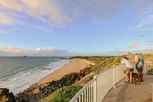 People Enjoying The Sunrise View From Lambert's Beach Lookout, Mackay Queensland Australia