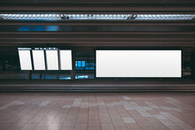 A Huge Rectangular Empty Billboard Mockup In An Airport Departure Area With Vertical LCD Screens Mock-ups; A White Blank Poster Template Indoors Of A Transport Terminal Near The Window And Gates