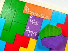 Business Concept.Text Progressive Web Apps Writing On Wooden Puzzle On A White Background.