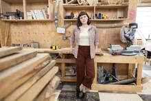 Portrait Confident Female Woodworker In Workshop