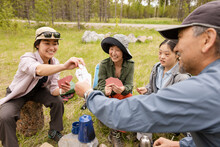 Family Playing Cards In Forest