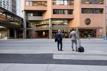 Businessmen Waiting On City Sidewalk