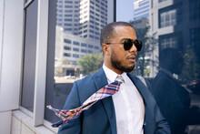 Wind Blowing Necktie On Stylish Businessman In Sunglasses