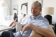 Portrait Happy Senior Man Drinking Coffee In Living Room
