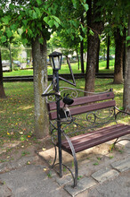 Beautiful Bench In The City Park. Bench With A Figure Of A Man With A Lantern Instead Of A Head. Urban Sculpture. 02 August 2021, Smolensk, Russia.