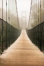Suspension Bridge In The Mist
