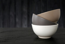 Stylish Empty Ceramic Bowls On Black Table, Space For Text. Cooking Utensils