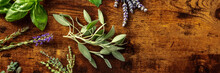 Fresh Aromatic Herbs Panorama With Sage And A Place For Text, Shot From Above On A Rustic Wooden Background