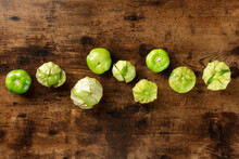 Tomatillos, Green Tomatoes, Shot From Above With Copy Space. Mexican Cuisine Ingredient On A Dark Rustic Wooden Background