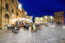 Montefalco Umbria Italy. Piazza Del Comune At Sunset. People Eating Out