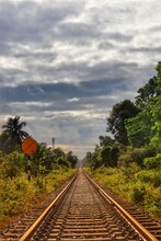 Railway Track With Cloudy Sky