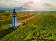 Landmark Church In Colorful Farm Crop Fields In Slovenia Countrtyside