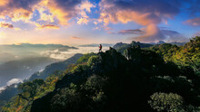 Backpacker Standing On Sunrise Viewpoint At Ja Bo Village, Mae Hong Son Province, Thailand.