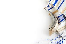 Yom Kippur, Rosh Hashanah, Jewish New Year Holiday, Concept. Religion Image Of Shofar - Horn On White Prayer Talit.