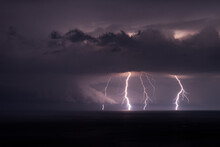 Multiple Lightning Bolts During A Thunderstorm Over The Black Sea.