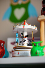 Closeup Of A White Musical Carousel Toy With Horses In Children's Room