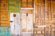 Collage Of Retro Vintage Style Wooden Doors With Rusty Latch And Knockers For Buildings Or House Facade