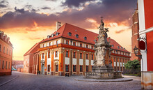 Wroclaw, Poland. Saint John Nepomuk Monument At Cathedral Island. Sunset Over Old Town And Deserted Square.