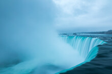 A Stormy Morning Over The Iconic Niagara Falls Located On The Boarder Of The United States And Canada.