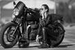 young woman on a black motorcycle