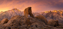 Lady Boot Arch At Sunrise, With The Sierra Range Glowing Behind. Alabama Hills, Lone Pine, California