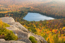 A Hiker Overlooking Heart Lake From Near The Summit Of Mount Jo In New York's Adirondack Mountains.