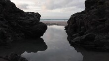 Relaxing Rockpool With Reflections In Cornwall