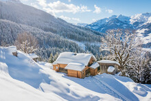 Beautiful Winter Mountain Landscape With Snowcapped Wooden Hut