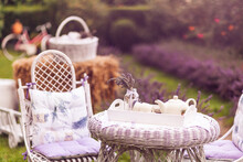 Garden Decor - Chair And Table With Blooming Lavender On The Background