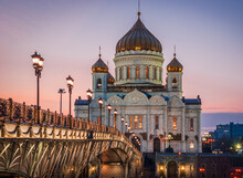 Cathedral Of Christ The Savior With Beautiful Illumination In The Light Of Evening City Lighting. Cityscape At Sunset.