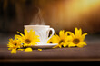filiżanka kawy w jesienny poranek, kawa o poranku i żółte kwiaty słonecznika
