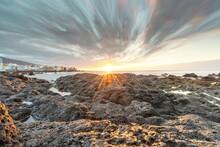 Sunset At Playa Jardín, Pebble Beach With Sea And Sun Setting Puerto De La Cruz, Tenerife
