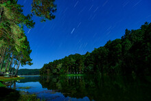 Landscape Of Night Camping With Stars Tail In Pang-Ung Pine Forest Trees And Nature, Mae Hong Son, Thailand, Asia.